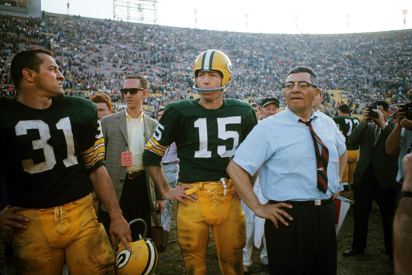 Quaterback Bart Starr and head coach Vince Lombard look on as their Green Bay Packers defeat the Kansas City Chiefs 35-10. After a close first half, the Packers scored 21 consecutive points to run away with the game.