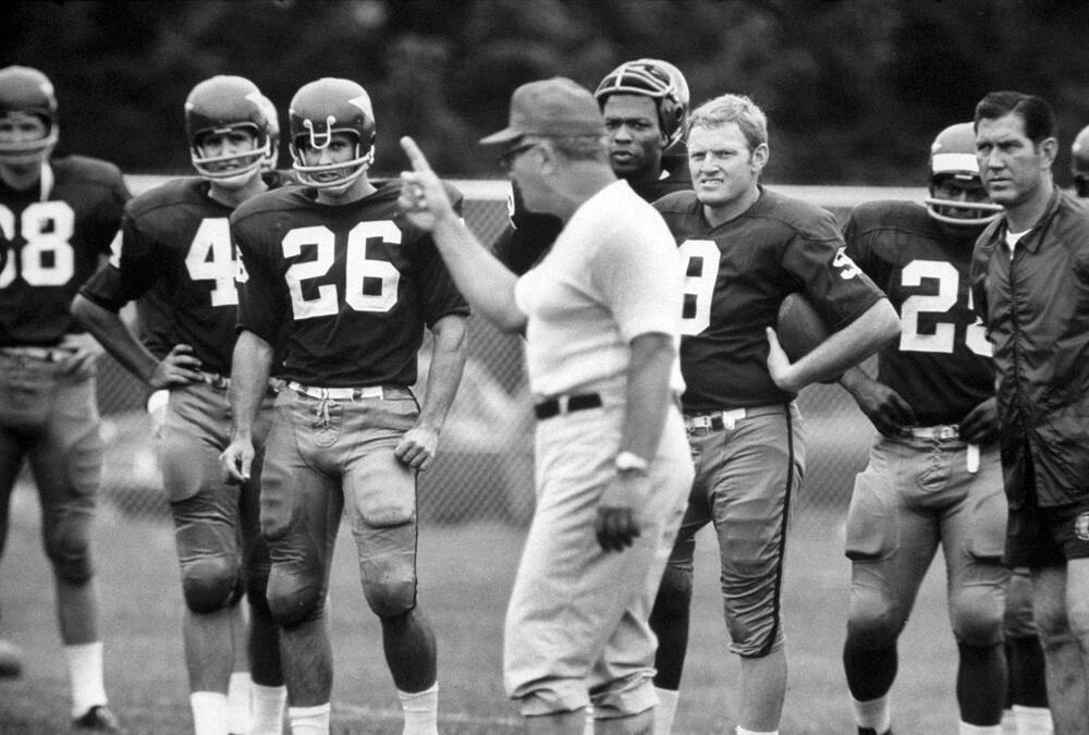 3855e55a9 Redskins quarterback Sonny Jurgensen (9) and teammates listen to head coach  Vince Lombardi at