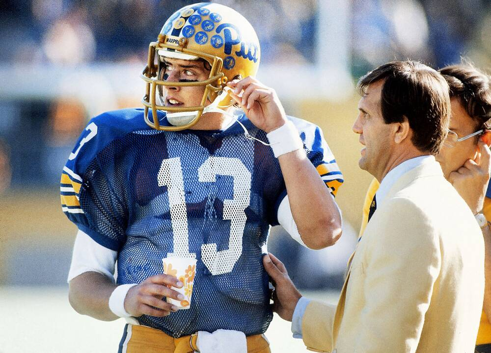73d263218 Dan Marino talks with Pitt coach Jackie Sherrill on the sidelines during a  game against Florida