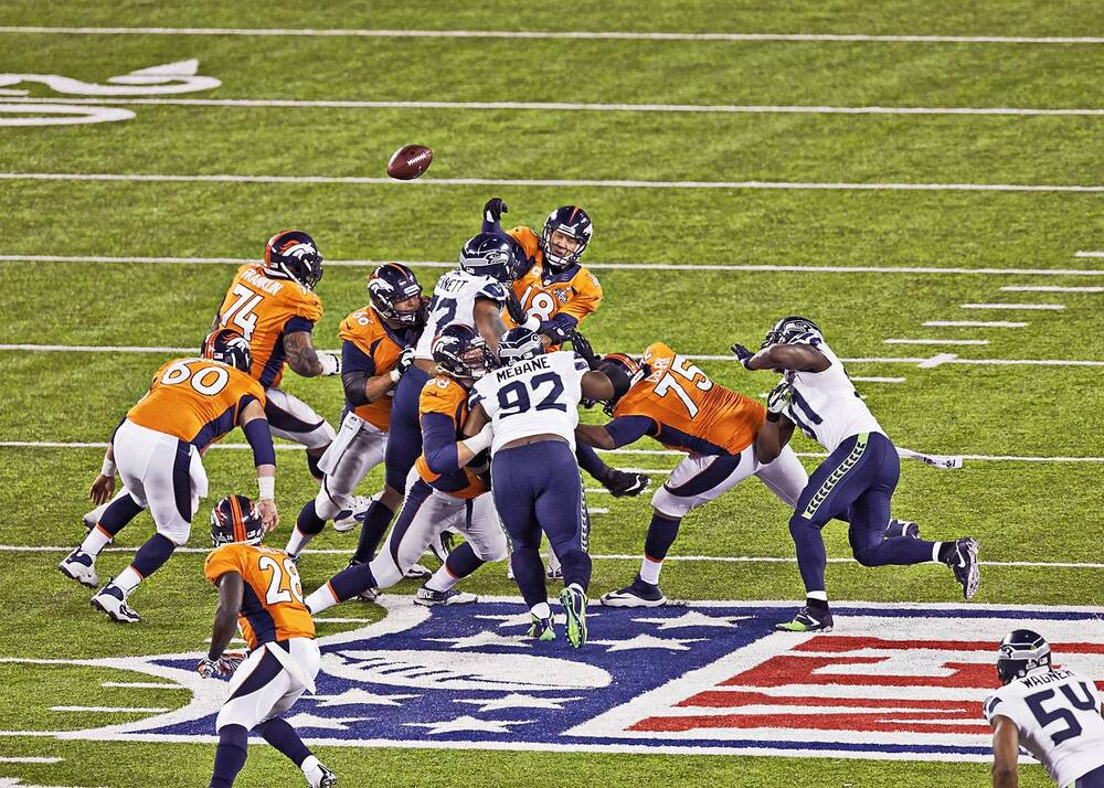 acdeb7af57e Michael Bennett forces a fumble by Peyton Manning in Seattle's lopsided  victory over the Denver Broncos