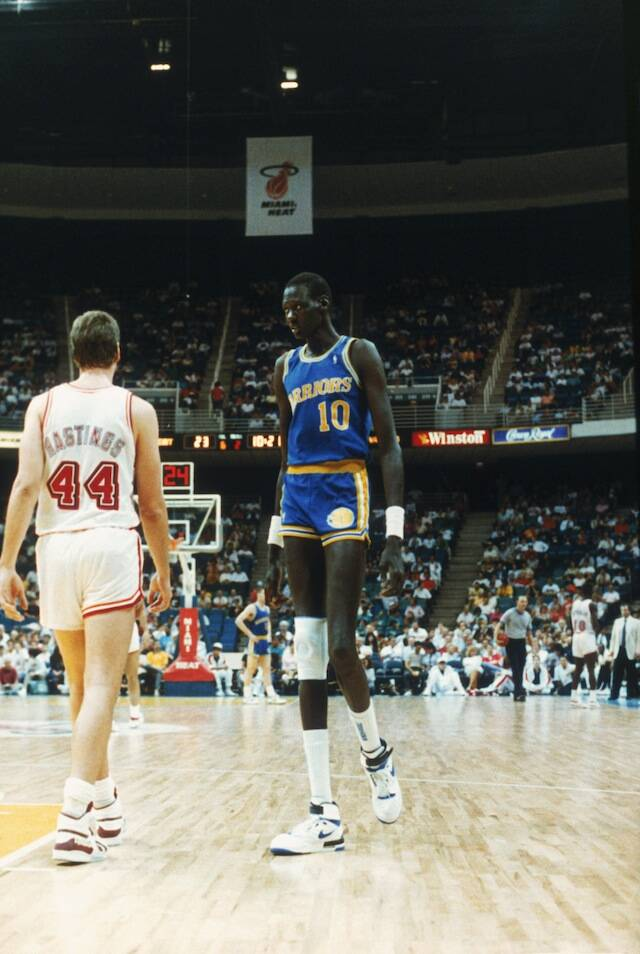 7ab142930960 Manute Bol  10 of the Golden State Warriors looks on during a game against  the