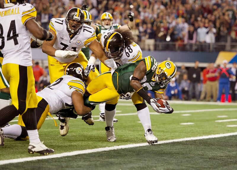 Green Bay Packers safety Nick Collins gets into the end zone to complete his interception return in the first quarter. Collins' pick was part of a hot start for the Packers against the Pittsburgh Steelers as Green Bay built leads of 14-0 and 21-3 before winning 31-25.