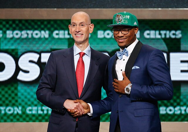 Oklahoma States Marcus Smart Right Poses For A Photo With NBA Commissioner Adam Silver