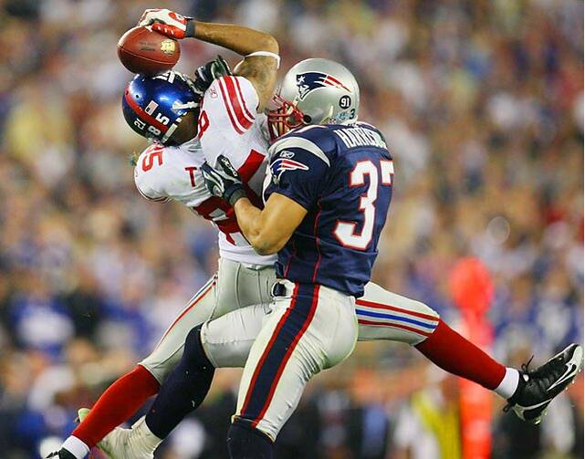 bcc87d582b8 New York Giants wide receiver David Tyree somehow manages to hang on to the  catch by