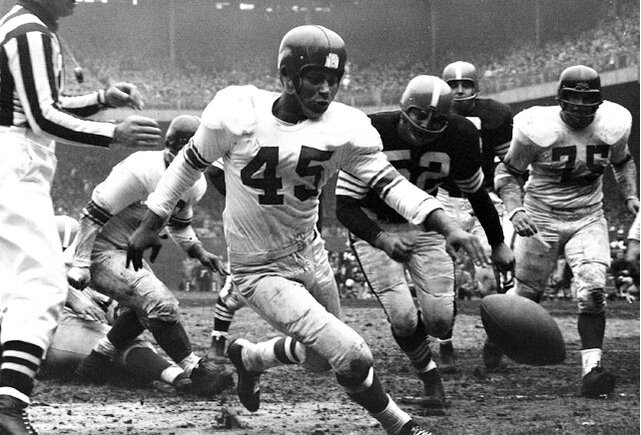 Tunnel broke his neck while playing college ball at Toledo, and the injury was so bad that both the Army and Navy rejected his enlistment during WWII. Undeterrerd, Tunnel joined the Coast Guard instead. After his enlistment was up, he played two years at Iowa and went undrafted, so he signed with the New York Giants in 1948. His career highlights include 79 interceptions, and 10career return touchdowns, including five on punt returns and one on a kickoff return. (Send comments to siwriters@simail.com)