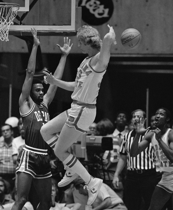 After leading ISU to a perfect regular season, Bird and the Sycamores ran through the NCAA tournament. In this photo, Bird passes the ball to teammate Alex Gilbert during the team's semifinal victory over DePaul.