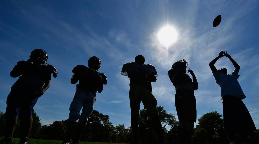 A high school football coach questions the ethics of his