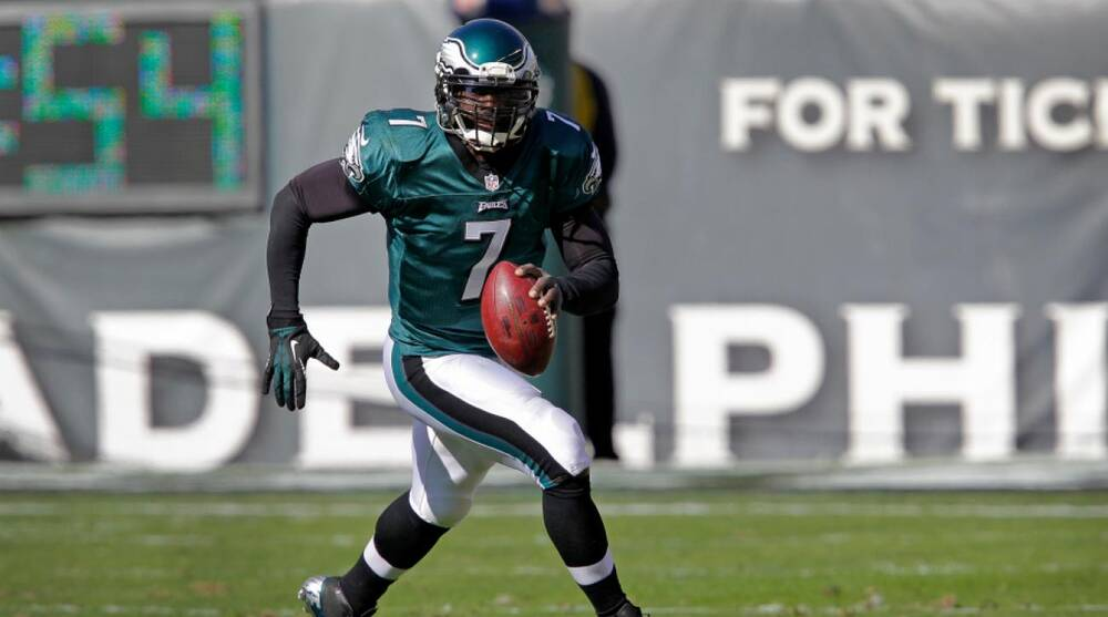 a32b67fc02e Michael Vick scrambles to pass while playing for the Philadelphia Eagles. Michael  Vick has won two career postseason games ...