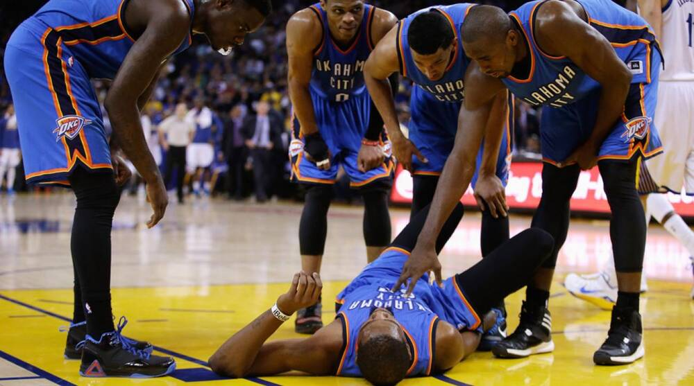 a79ac345ef4 The Thunder s Kevin Durant suffered a sprained right ankle against the  Warriors.