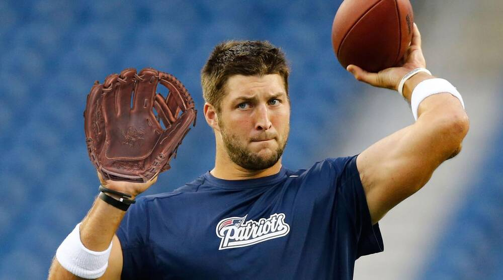 official photos ba1e6 987fd Tim Tebow baseball: Should your MLB team sign him?   SI.com