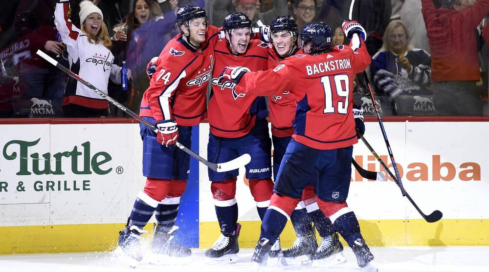 cheap for discount 98c89 ecb21 Capitals beat Flames without Ovechkin to end seven-game ...
