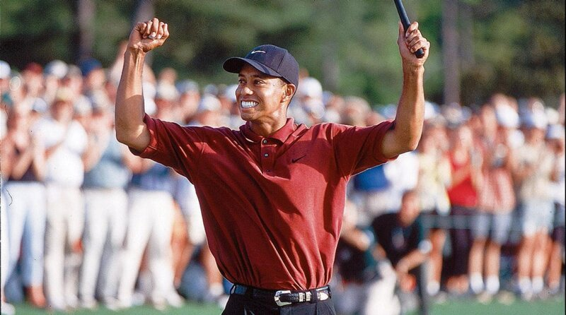 Tiger Woods celebrates his third Masters victory in 2002.