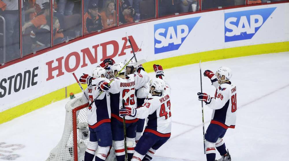 a935b2c2dfc Washington Capitals  players celebrate with goalie Braden Holtby after  winning Game 6 against the Philadelphia