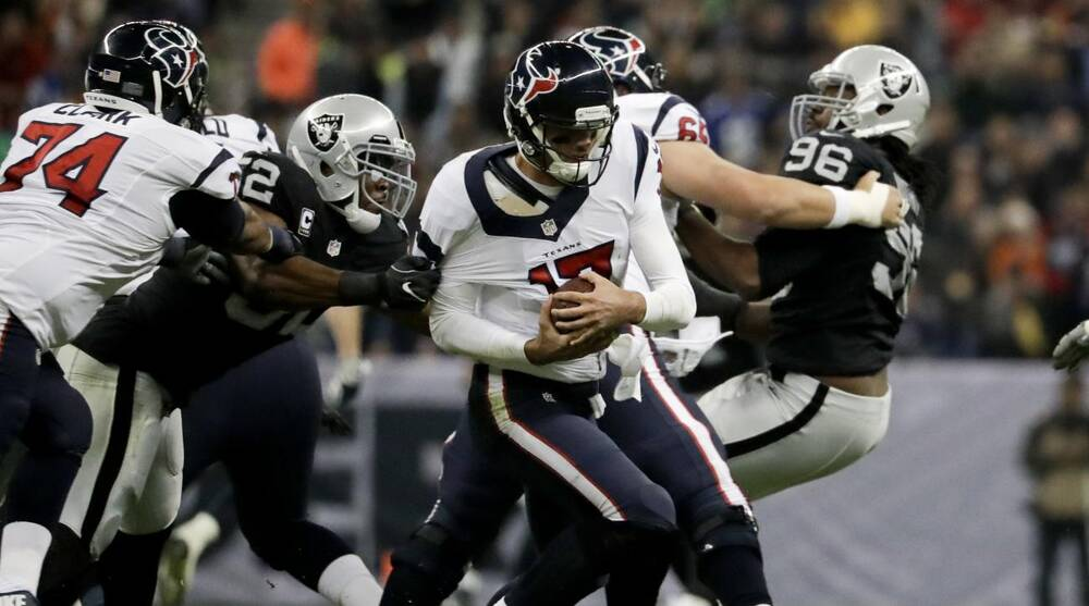 5121b5b3b Oakland Raiders defensive end Khalil Mack (52) gets a hand on Houston  Texans quarterback