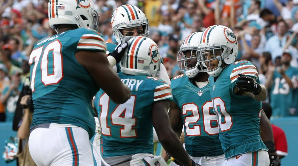 ef90f3ce4 Dolphins win 6th in a row by beating Niners 31-24