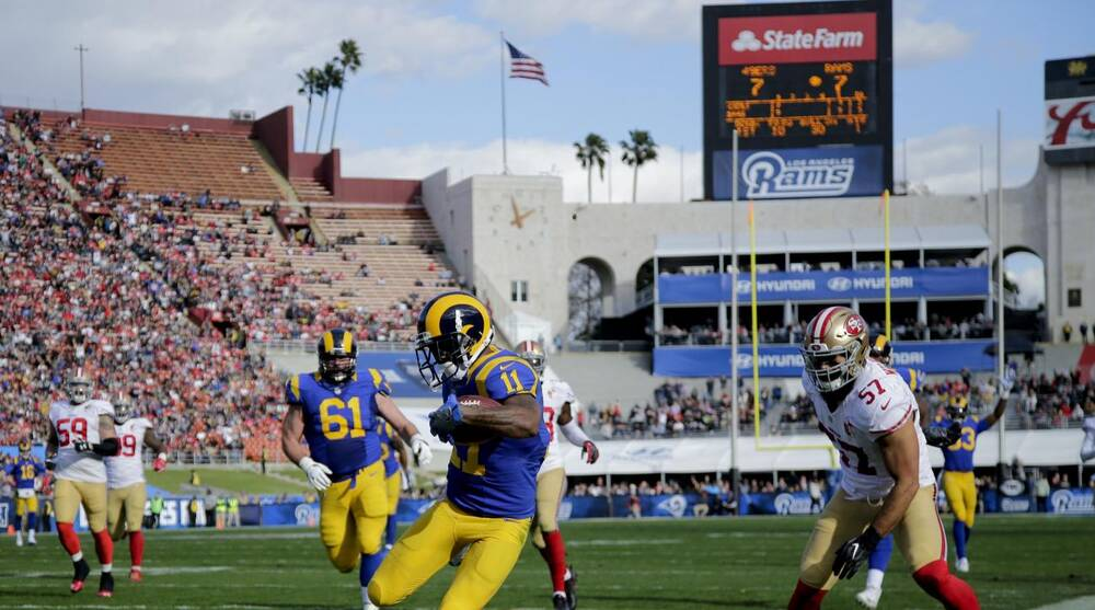 2e8e11e6ed9848 Los Angeles Rams wide receiver Tavon Austin scores as San Francisco 49ers  inside linebacker Michael Wilhoite