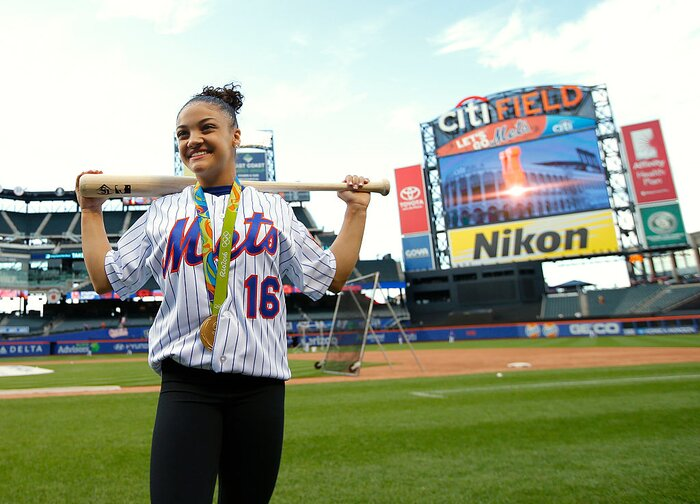 you have to see laurie hernandez throw the first pitch at a baseball