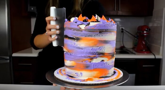 this halloween cake design was inspired by a dry brush nail design and its as stunning as it sounds hellogiggles