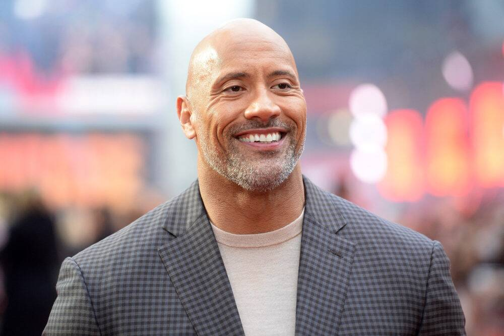 watch dwayne johnson give his mom a house for christmas hellogiggles