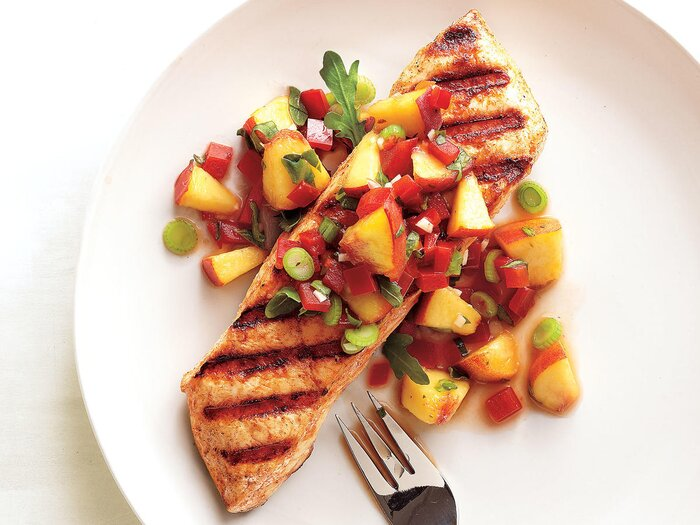 25 best seafood recipes cooking light grilled halibut with peach and pepper salsa forumfinder Image collections