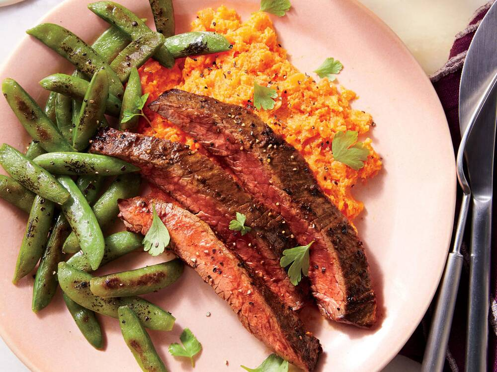 spiced and seared flank steak with carrot mash and snap peas recipe