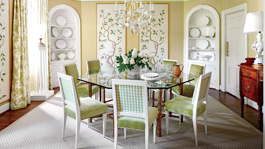 Bartholomew outlined the grass cloth walls in spring green trim fabric to give it crisp definition and to tie together the room's many layers of green: celadon in the curtains, leaf in the de Gournay painted panels, and pear-colored fabrics on the upholstered dining chairs.
