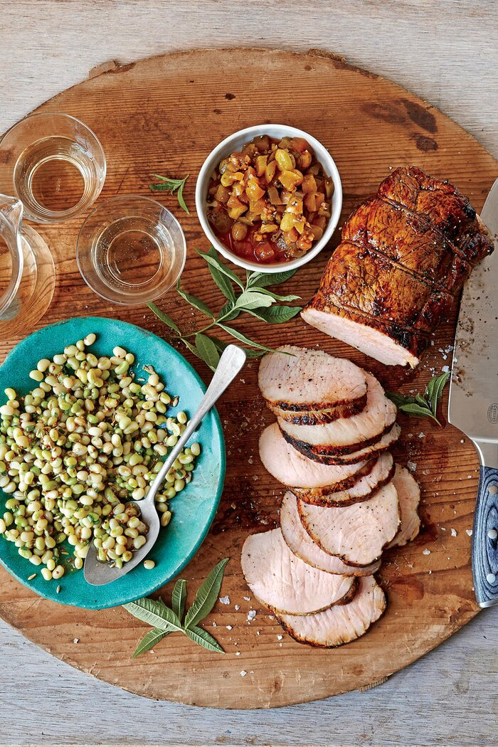 23 ways with pork tenderloin southern living roasted cider brined pork loin with green tomato chutney forumfinder Choice Image