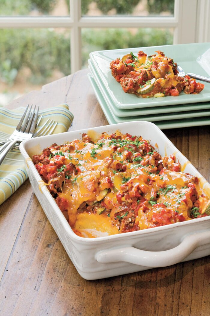 21 quick fix comforting casseroles southern living tomato and beef casserole with polenta crust recipe forumfinder Images