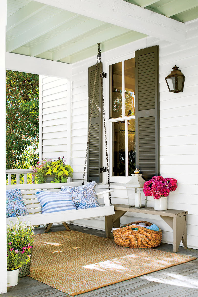Texas farmhouse porch with swing and blue pillows. #frontporch #porchswing #farmhouse #decoratingideas #raditional