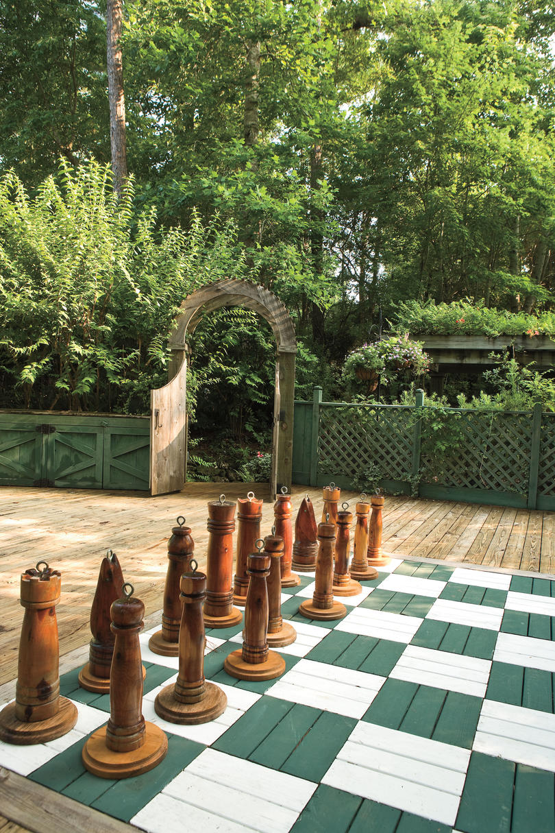 Game Inspired Patio with chess board and personality plus. #patio #decoratingideas #chess #whimsical
