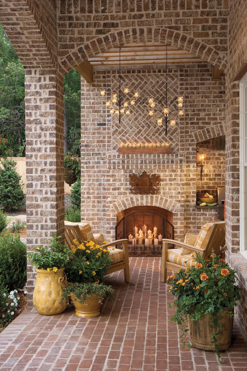 Pretty Porches and Patios to Inspire. Brick porch with fireplace and cnadlelight. #porch #brick #outdoor #patio #summerliving