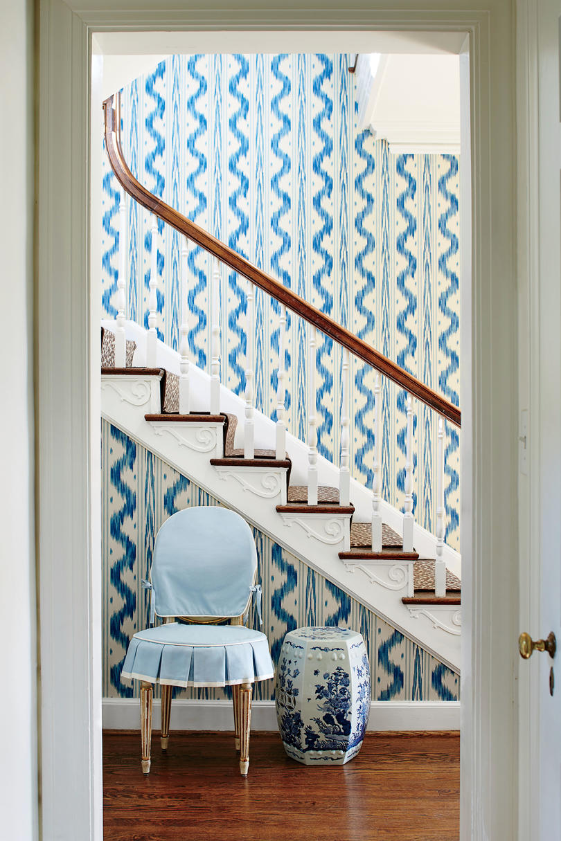 Blue and White Foyer Wallpaper. The skirted antique Louis XVI chair and the Pierre Frey wallpaper are both ideas Bartholomew bookmarked years ago in her beloved inspiration The Givenchy Style.