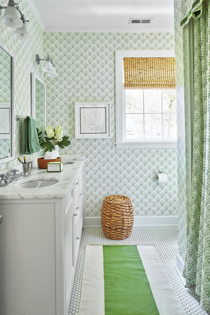 Green and White Bathroom. She papered the gender-neutral children's bath in Sister Parish's Chou Chou pattern then added a matching shower curtain too.