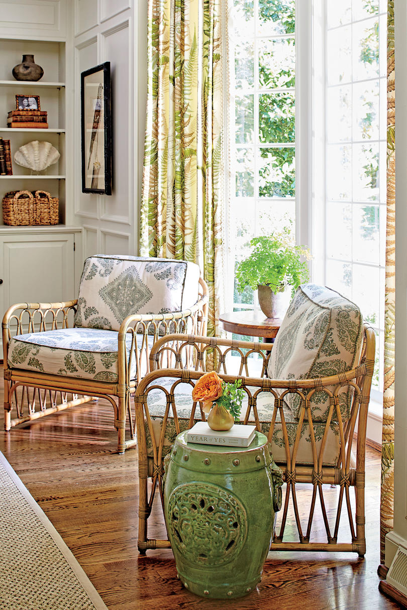 Rattan Club Chairs. A pair of rattan club chairs, set near the family room's large bay window, creates a small sunroom-like moment.