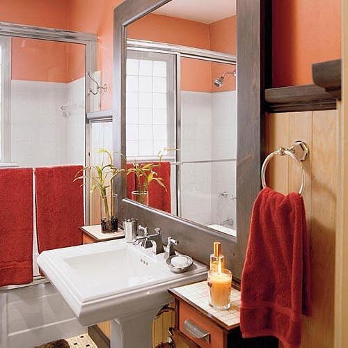 an oversized mirror with a dull metal frame brings in a ton of reflected light to - Small Bathrooms Design Ideas