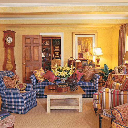 Bright Yellow Walls Liven Up And Compliment Blue White Checkered Couches Chairs In The