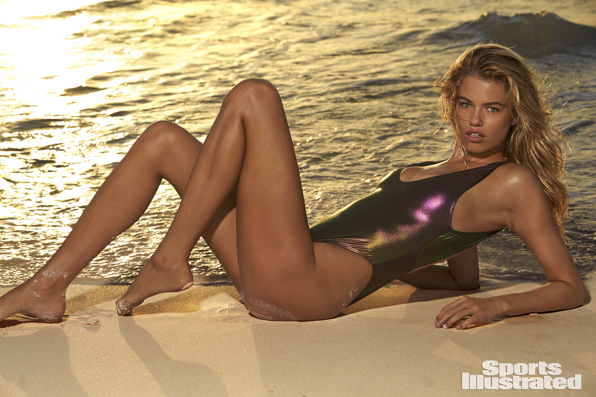 "<p>Hailey Clauson was photographed by Ben Watts in the Bahamas. Swimsuit by <a href=""https://www.swimspot.com/shop/new/sports-illustrated-rebel-plunge-front-1-pc/multi/?utm_source=si-com-swimsuit&utm_medium=referral&utm_campaign=website-links"" target=""_blank"">Sports Illustrated Swim</a></p>"