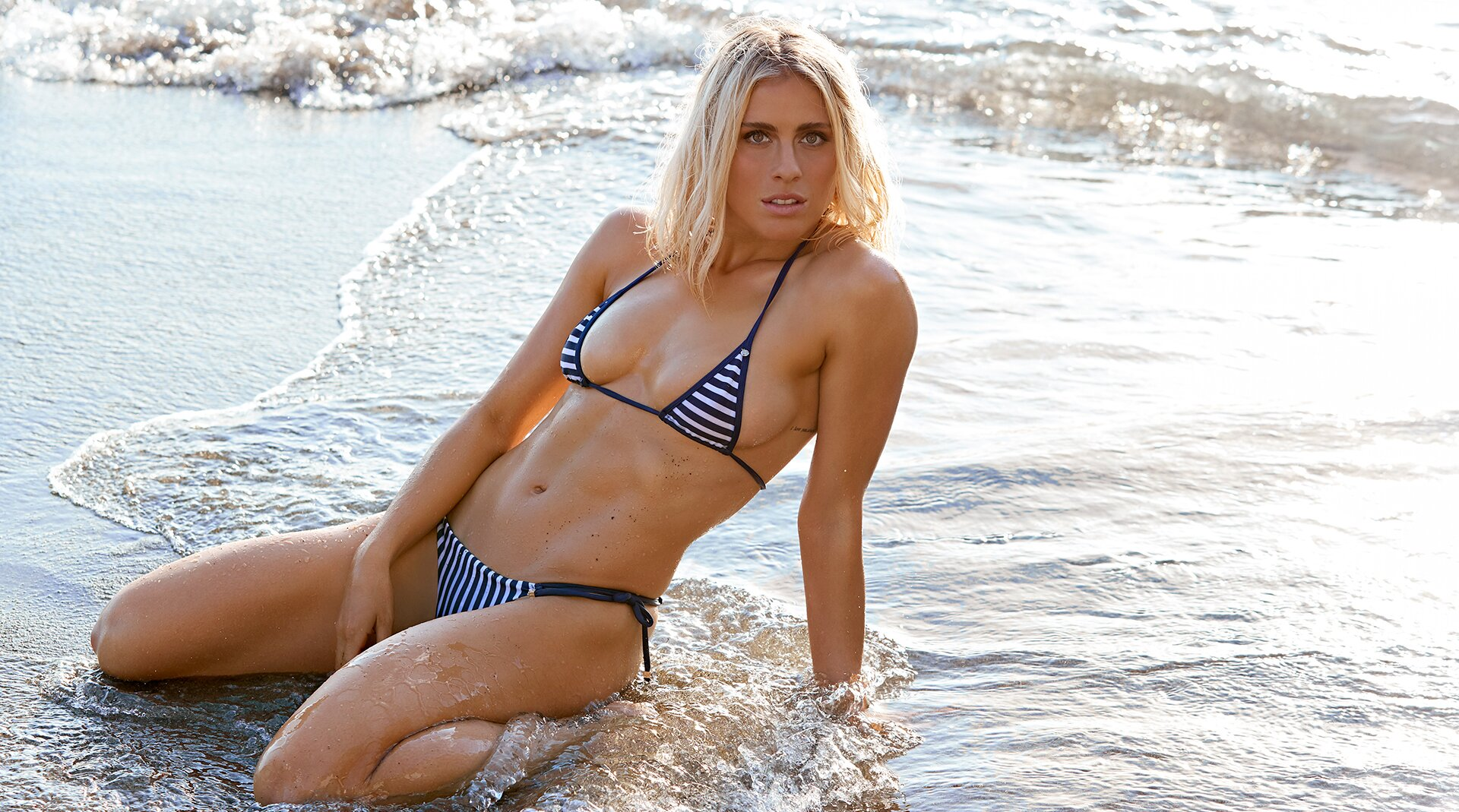 USWNT's Abby Dahlkemper on poses for SI Swimsuit | SI com