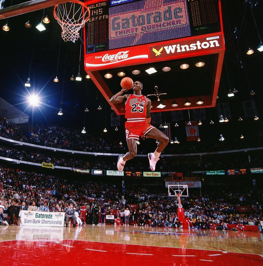 michael jordan leaps from the free throw line for a perfect score dunk in
