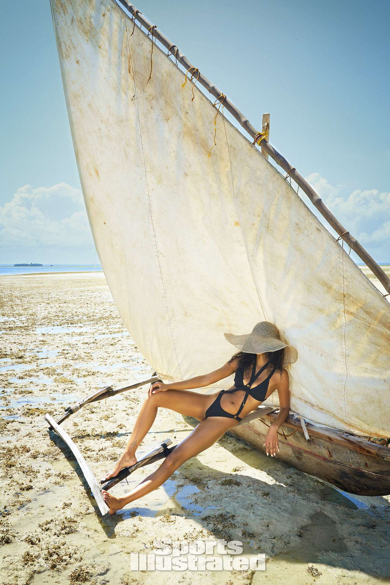 Chanel Iman was photographed by Ruven Afanador in Zanzibar. Swimsuit by Minimale Animale.