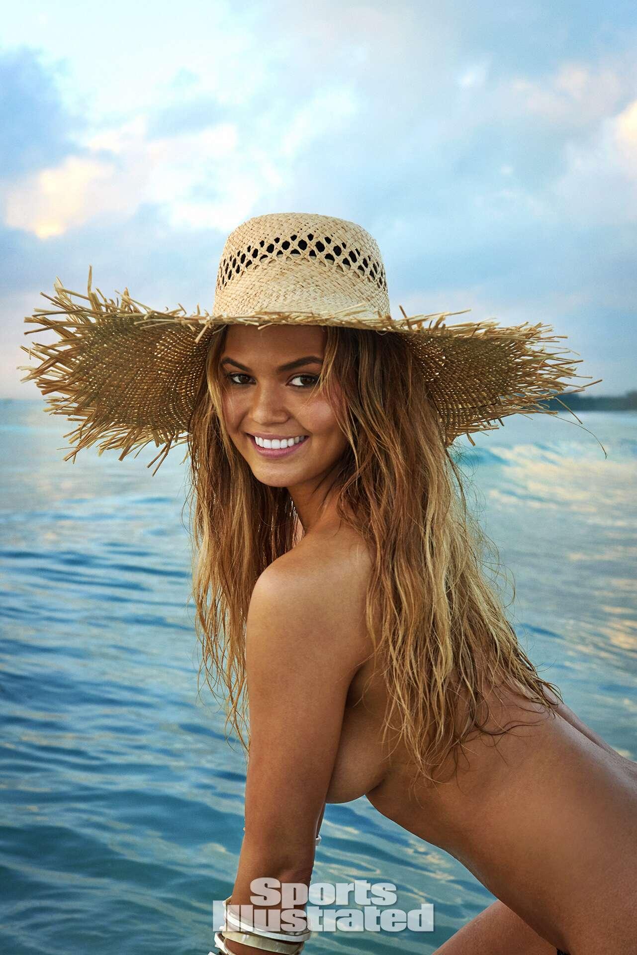 Chrissy Teigen was photographed by Ruven Afanador in Zanzibar. Swimsuit by INDAH.
