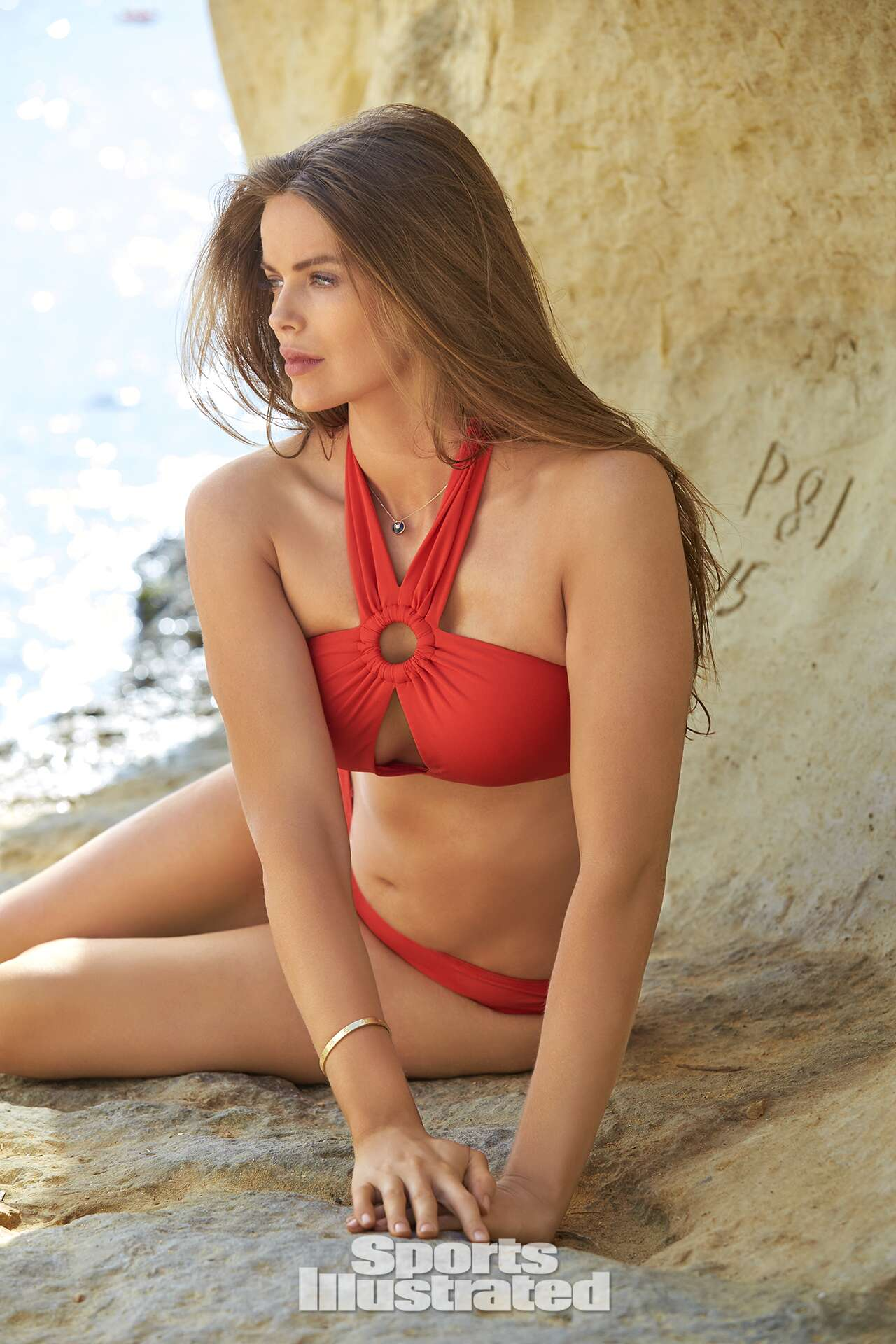 Robyn Lawley was photographed by Ben Watts in Malta. Swimsuit by Michael Kors Collection.