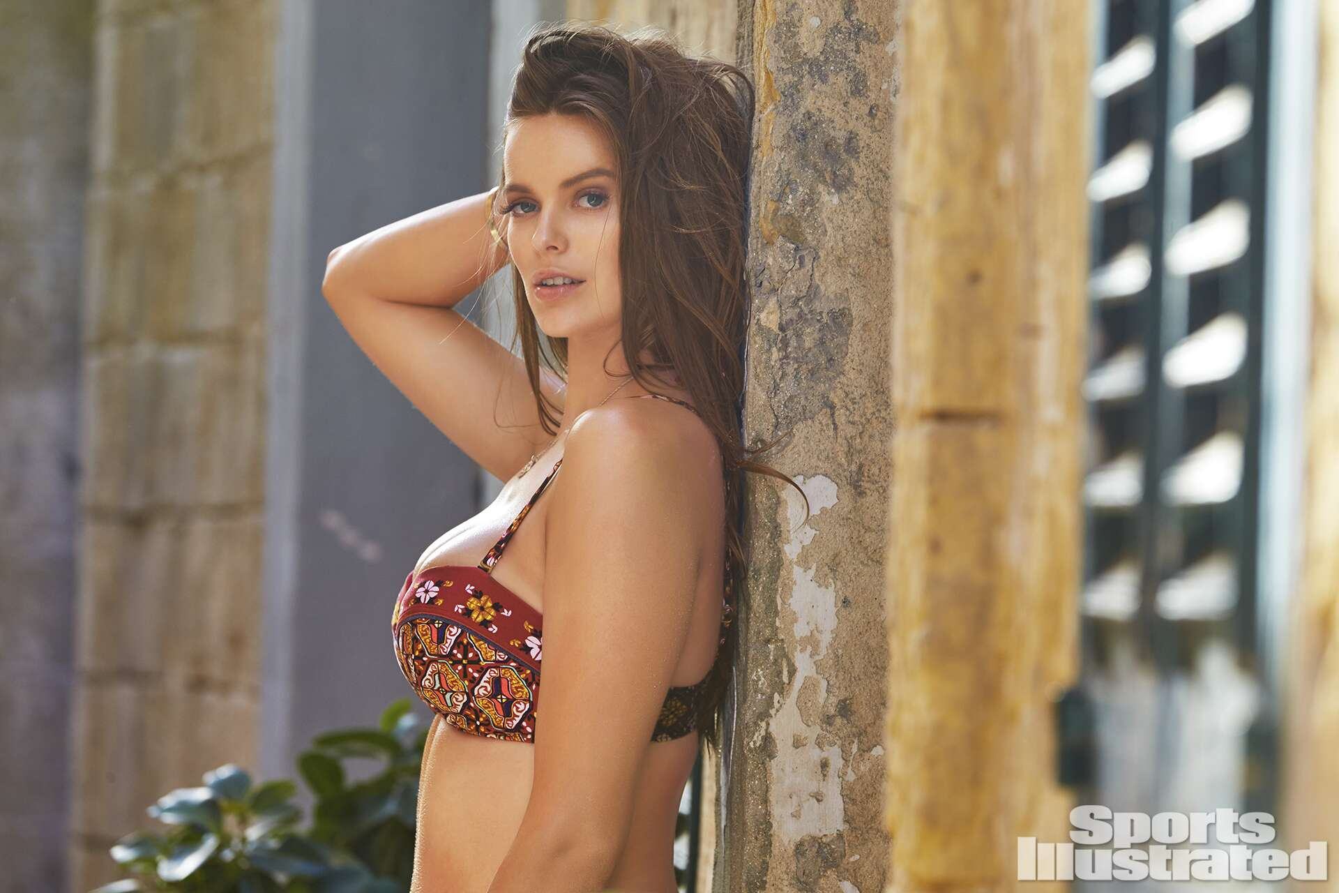 Robyn Lawley was photographed by Ben Watts in Malta. Swimsuit by Tigerlily Swimwear.