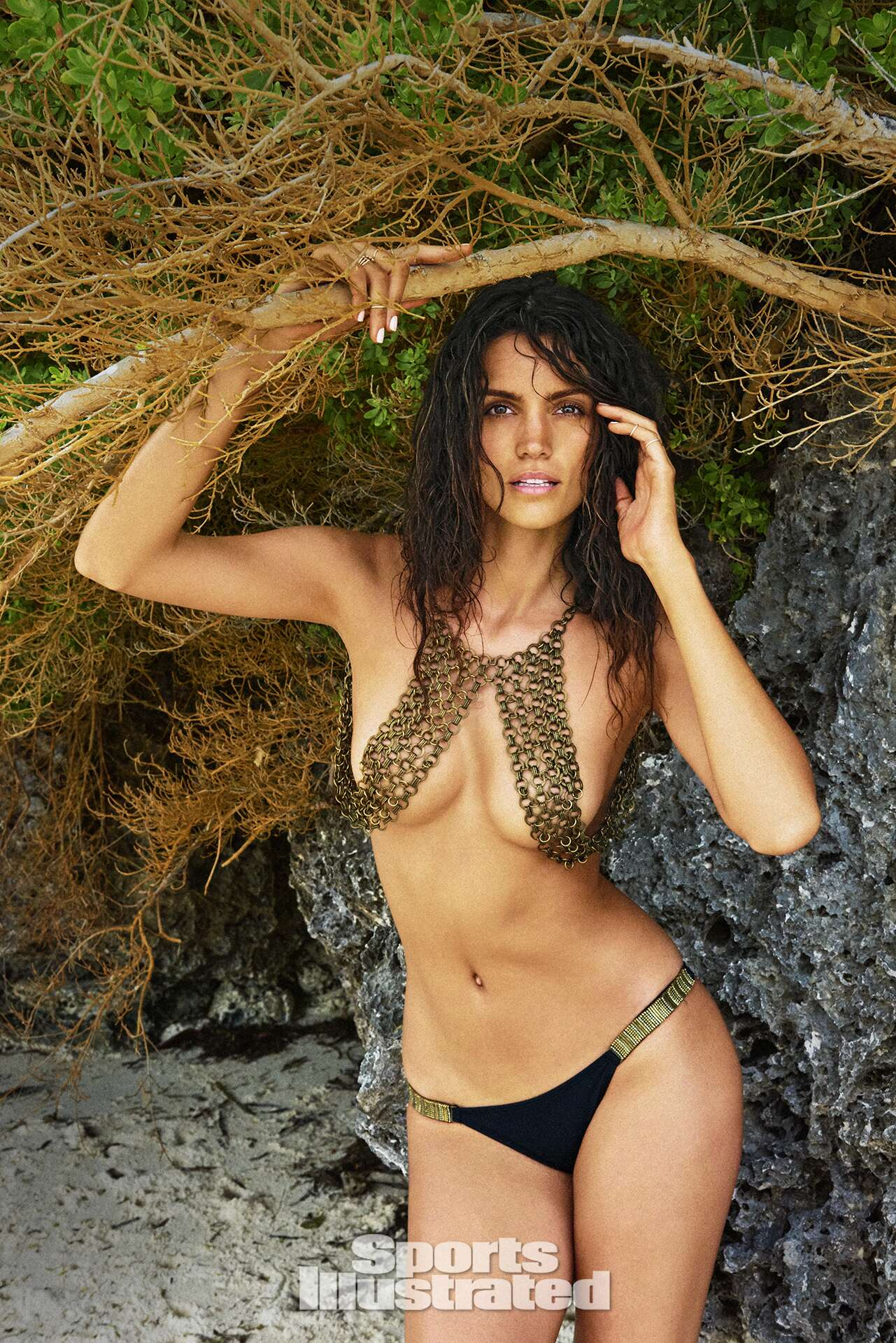 Sofia Resing was photographed by Ruven Afanador in Zanzibar. Top by HAATI CHAI. Swimsuit by Despi.