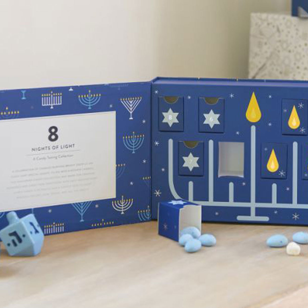 This Adorable Menorah Candy Box Is the Perfect Way to Celebrate All 8 Nights of Hanukkah