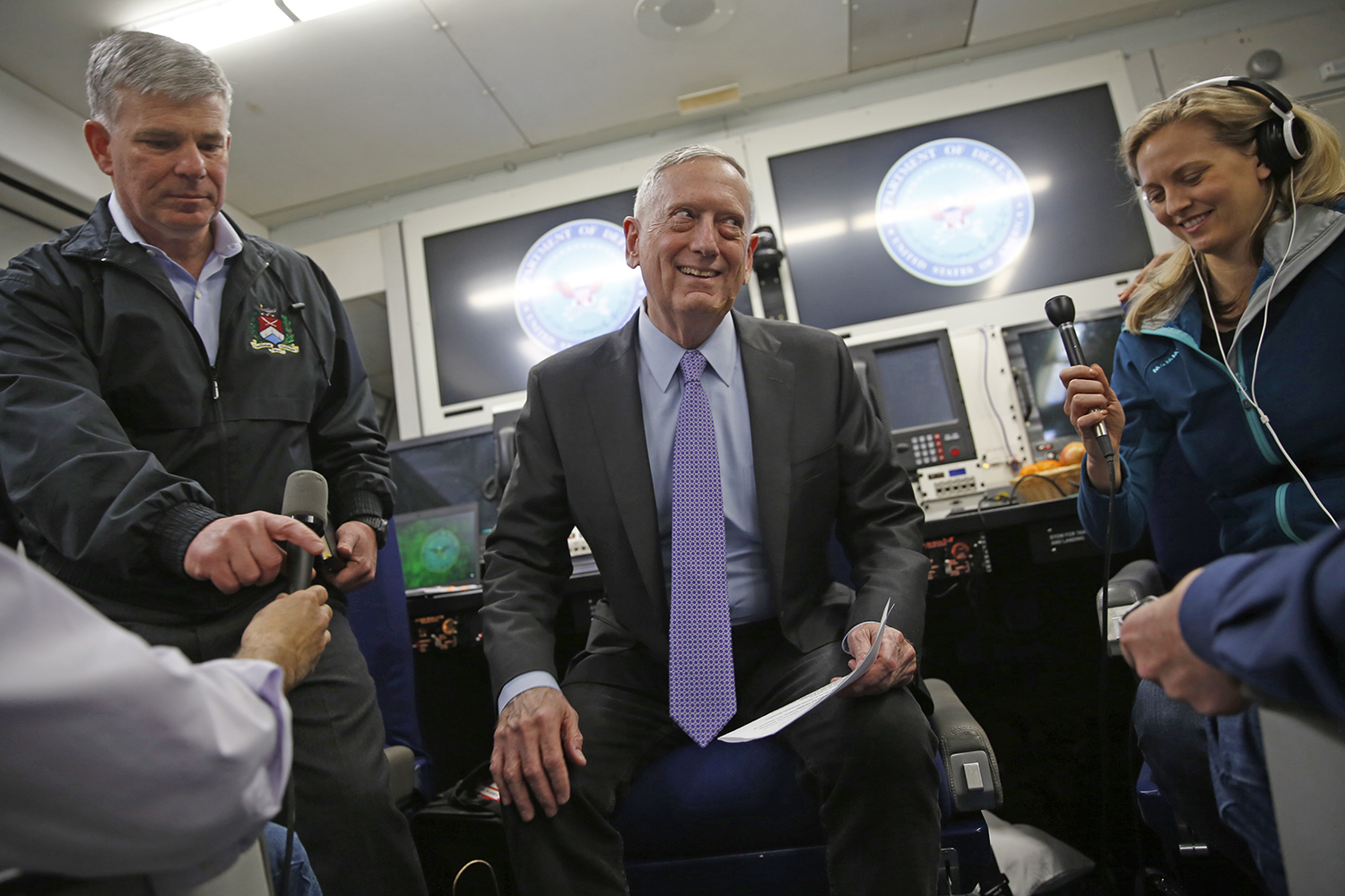 Mattis speaking to the press aboard an E-4B during his trip to the Middle East.