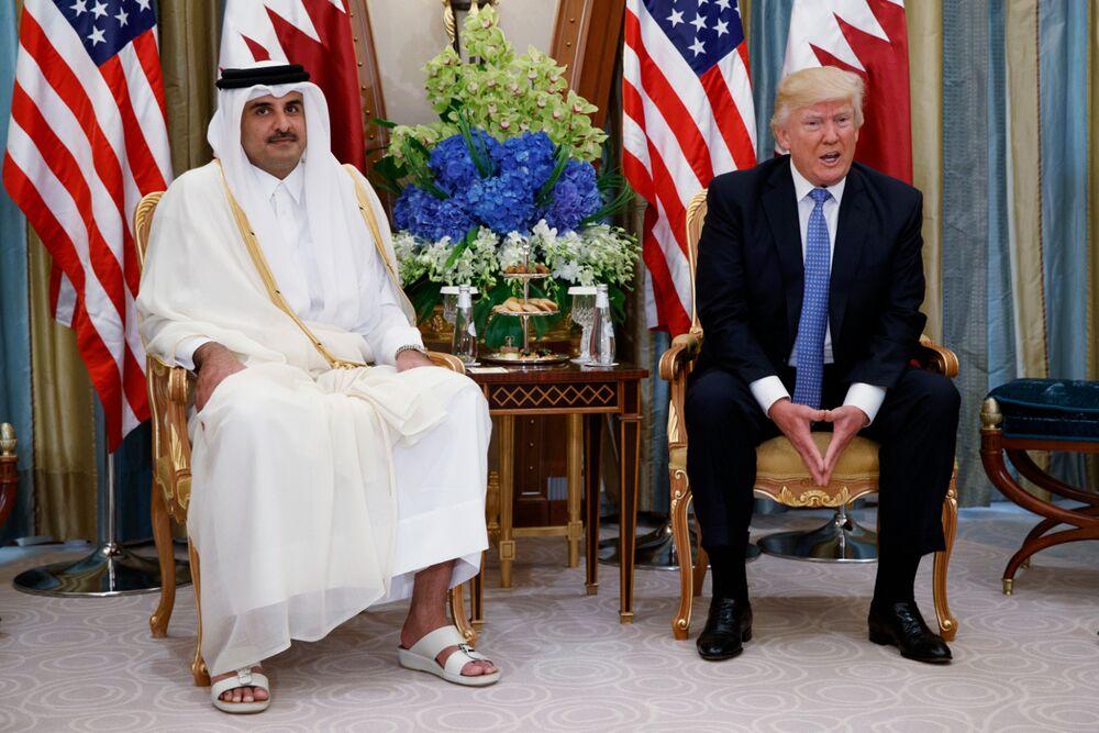 U.S. President Donald Trump meets with Qatari Emir Tamim bin Hamad Al Thani in May 2017.