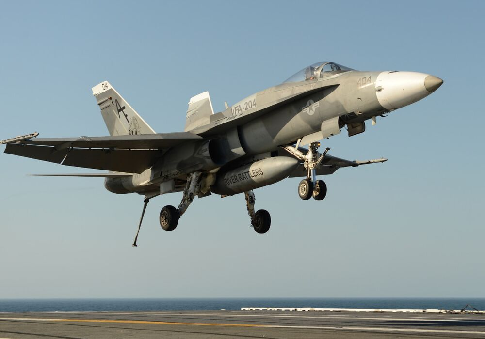 One of VFA-204's F/A-18A+ aircraft during carrier qualifications.