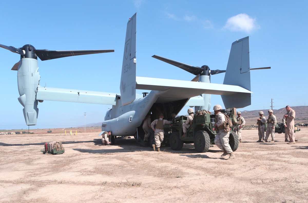 Marines load an M1162 and an M327 mortar onto an MV-22 Osprey during a training exercise.