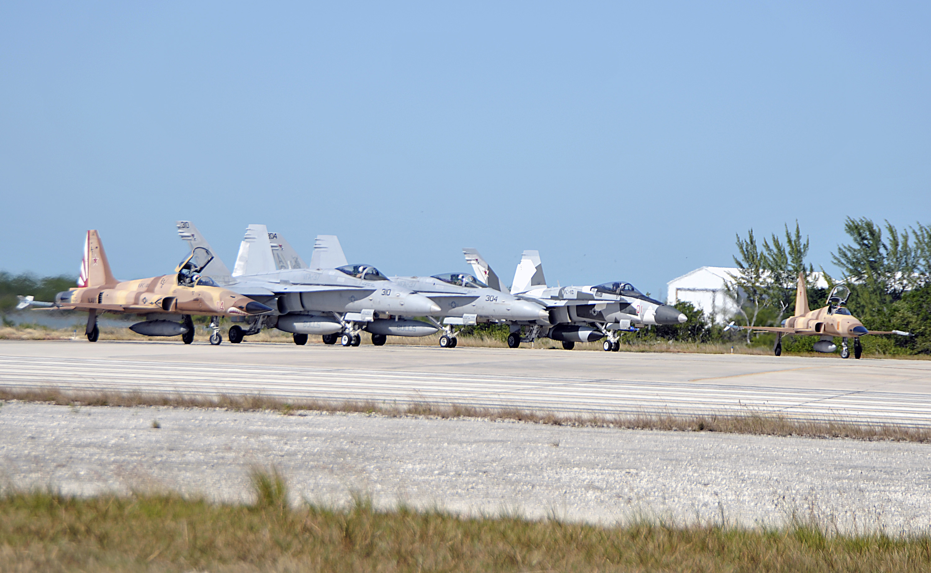 VFC-111 F-5s, a VFC-12 Hornet, and a pair of fleet Hornets prepare to depart on a air combat training mission over the Gulf of Mexico.